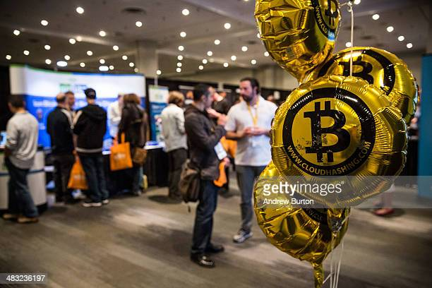 People attend a Bitcoin conference on at the Javits Center April 7 2014 in New York City Topics included market places to trade bitcoin mining...