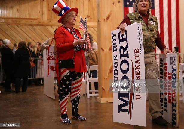 People attend a campaign rally for Republican Senatorial candidate Roy Moore at Jordan's Activity Barn on December 11 2017 in Midland City Alabama Mr...