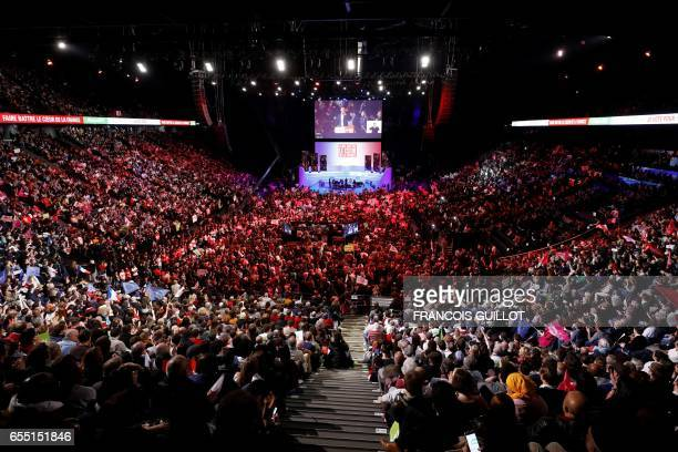 TOPSHOT People attend a campaign rally of French Socialist Party presidential candidate Benoit Hamon at the AccorHotels Arena in Paris on March 19...