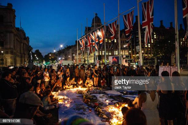 People attend a candle lit vigil for the victims of the Grenfell Fire disaster at Parliament Square on June 19 2017 in London England Seventynine...