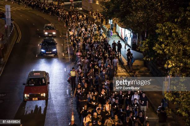 People attend a candlelight march for the late Chinese Nobel laureate Liu Xiaobo in Hong Kong on July 15 2017 Liu died on July 13 after a battle with...