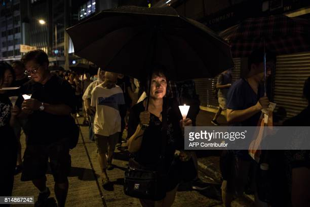 TOPSHOT People attend a candlelight march for the late Chinese Nobel laureate Liu Xiaobo in Hong Kong on July 15 2017 Liu died on July 13 after a...
