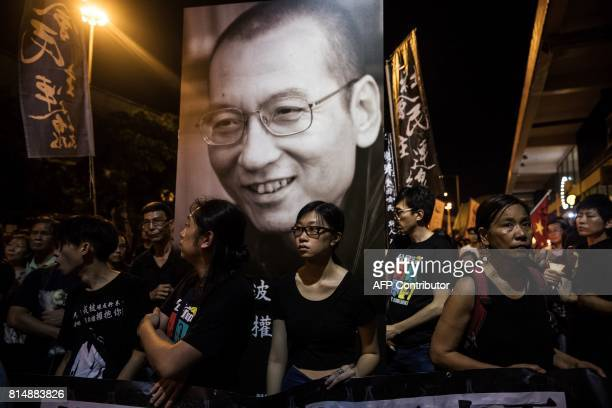 People attend a candlelight march for the late Chinese Nobel laureate Liu Xiaobo in Hong Kong on July 15 2017 The ashes of China's late Nobel...