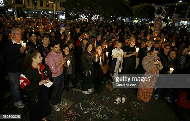 People attend a candlelight vigil for the victims of the Pulse Nightclub shooting in Orlando Florida at Newtown Neighbourhood Centre on June 13 2016...