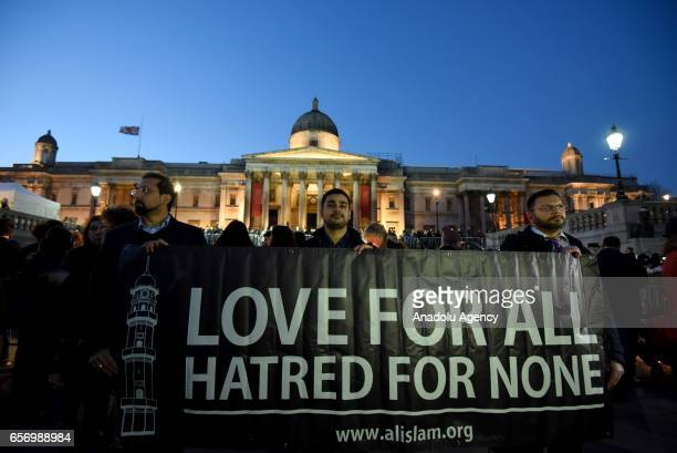 People attend a candlelit vigil at Trafalgar Square on March 23 2017 in London England Four people were killed in Westminster London yesterday in a...