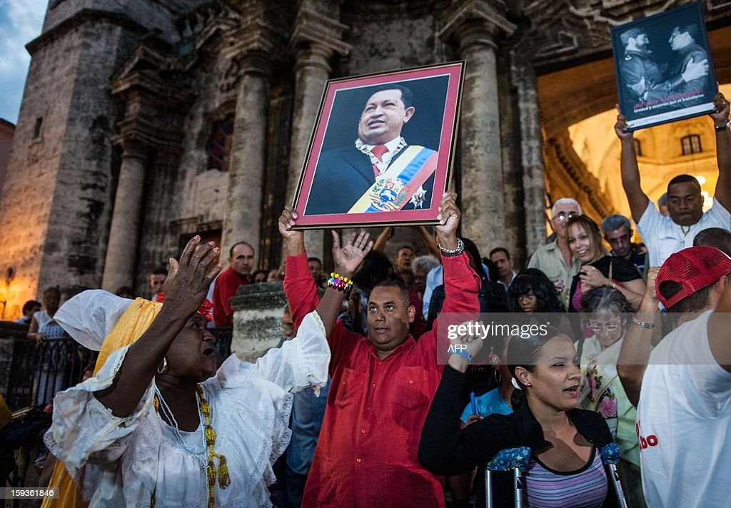 People attend a Catholic mass for the health of Venezuelan President Hugo Chavez in Havana on January 12, 2013. Venezuelan Vice President Nicolas Maduro was in the Cuban capital Saturday, saying he wanted to visit ailing Chavez whose month-long absence following cancer surgery has rattled his nation. Complications from cancer surgery forced the government to delay the re-elected leader's inauguration on Thursday. AFP PHOTO / YAMIL LAGE