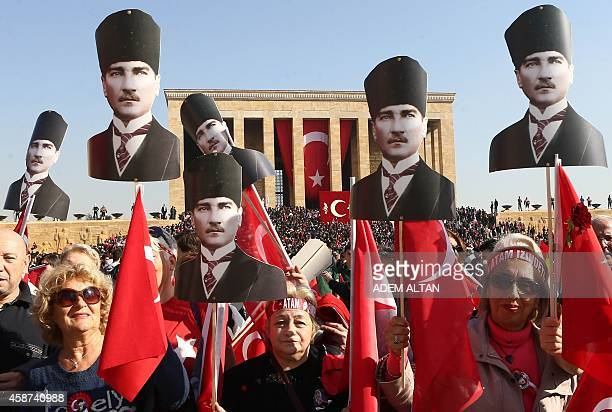 People attend a ceremony at the mausoleum of Mustafa Kemal Ataturk Turkish Republics founder marking the anniversary of his death on November 10 2014...