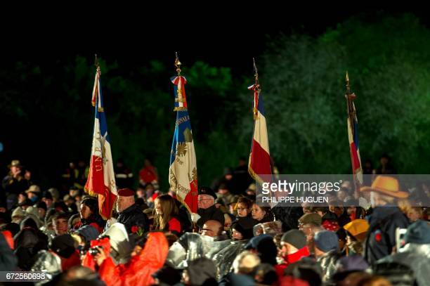 People attend a ceremony during Anzac Day at the military cemetery of the Australian National Memorial in VillersBretonneux northern FRance on April...