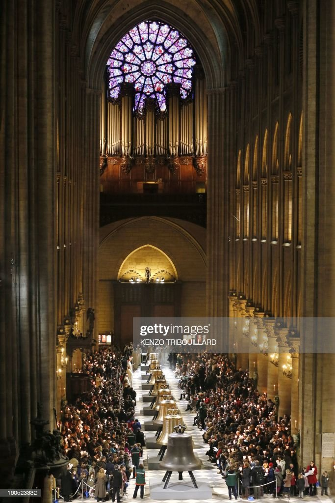 People attend a ceremony to inaugurate nine new church bells on February 2, 2013 at Notre-Dame de Paris Cathedral in Paris. Hundreds of pupils attend the ceremony during a jubilee.