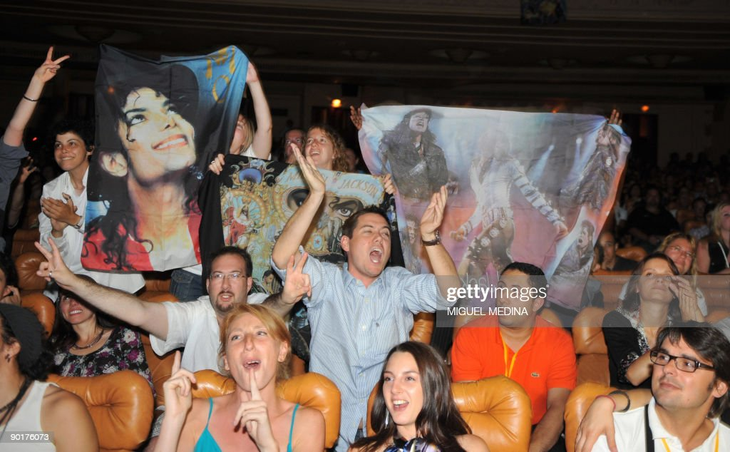 People attend a ceremony to pay tribute to US singer Michael Jackson on August 29, 2009 on what would have been his 51st birthday, in The Grand Rex cinema, in Paris. In presence of Michael Jackson's wax figure, fans have seen, for the first time, all of Jackson's music videos on the biggest screen in Europe.