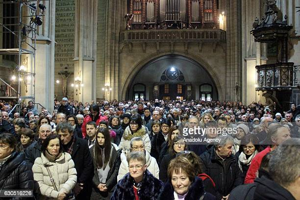 People attend a Christmas Eve mass in Zagreb Croatia on December 25 2016