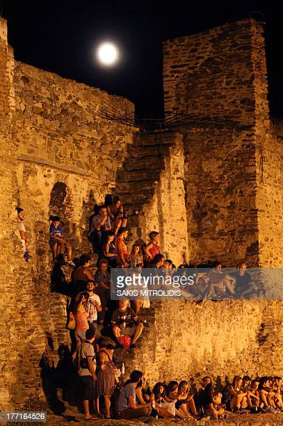 People attend a concert at a Byzantine castle in Thessaloniki as part of the full moon events on August 21 2013 Greece celebrates the August full...