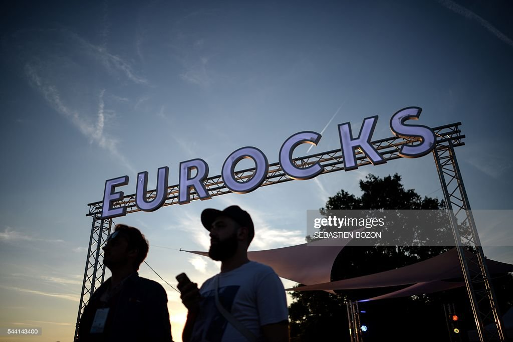 People attend a concert during the 28th Eurockeennes music festival on July 1, 2016 in Belfort. / AFP / SEBASTIEN