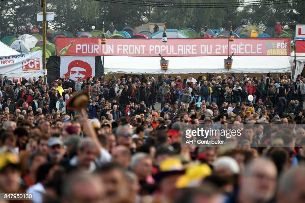 People attend a concert during the 82nd edition of the annual 'Fete de l'humanite' music festival organized by French newspaper L'Humanite in La...