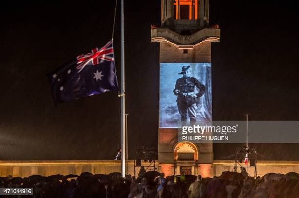 People attend a dawn ceremony marking the 100th anniversary of ANZAC Day at the Australian National Memorial on April 25 2015 in VillersBretonneux...
