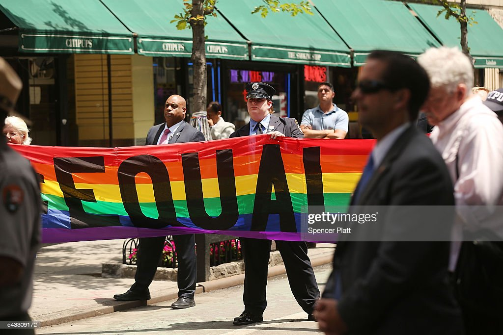 People attend a dedication ceremony officially designating the Stonewall Inn as a national monument to gay rights on June 27, 2016 in New York City. Elected and federal officials joined members of the LGBT community at the dedication ceremony of the historic bar that has played a pivotal role in the battle for the rights of people in the gay community. Valerie Jarrett, Senior Advisor to President Barack Obama, Director of the National Park Service Jonathan Jarvis, Mayor Bill de Blasio and others were all on hand for the afternoon ceremony.