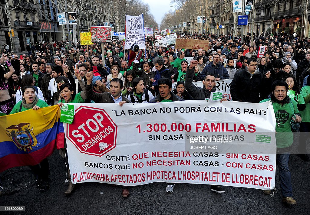 People attend a demonstration called by the organisation Platform for Mortgage Victims (PAH) to push for a new law to end a wave of evictions of homeowners ruined by the economic crisis, on February 16, 2013 in Barcelona. Similar protests were called in 50 other Spanish cities, the latest of months of demonstrations driven by anger at Spain's recession and the conservative government, which is imposing austere economic reforms. Campaigners passed a rare milestone on February 12, 2013 when the Spanish parliament agreed to debate a popular bill of measures to protect poor homeowners, backed by a petition that received more than 1.4 million signatures. Placard reads 'More than 1,300,000 families without housing and with debts.' AFP PHOTO/ JOSEP LAGO