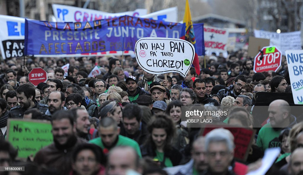 People attend a demonstration called by the organisation Platform for Mortgage Victims (PAH) to push for a new law to end a wave of evictions of homeowners ruined by the economic crisis, on February 16, 2013 in Barcelona. Similar protests were called in 50 other Spanish cities, the latest of months of demonstrations driven by anger at Spain's recession and the conservative government, which is imposing austere economic reforms. Campaigners passed a rare milestone on February 12, 2013 when the Spanish parliament agreed to debate a popular bill of measures to protect poor homeowners, backed by a petition that received more than 1.4 million signatures. AFP PHOTO/ JOSEP LAGO