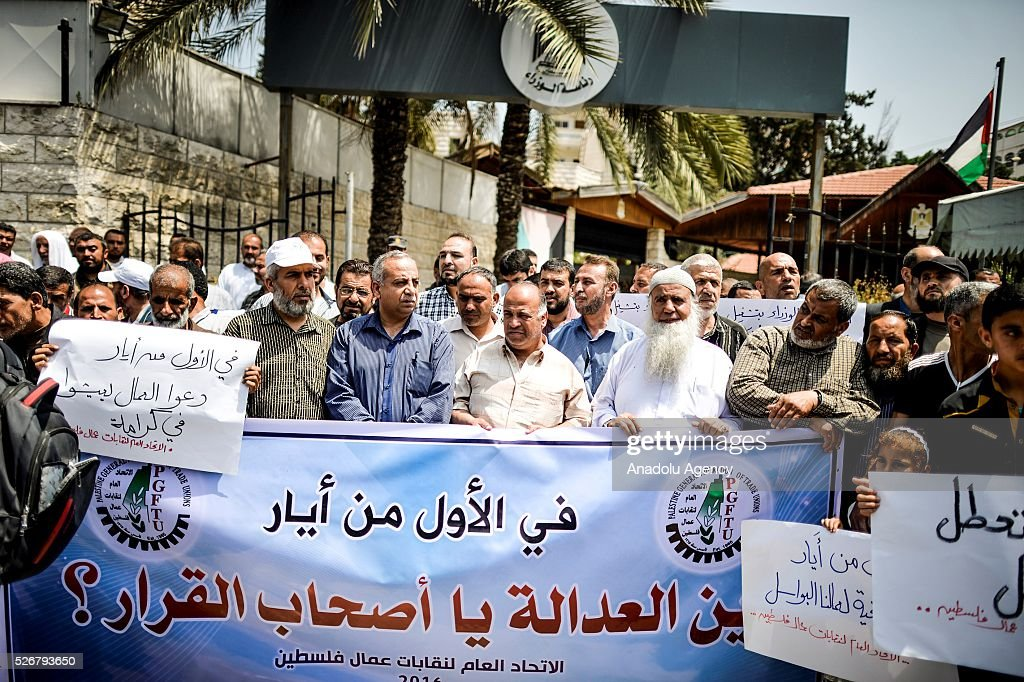 People attend a demonstration, demanding better working conditions for labors within May Day, International Workers' Day, celebrations in front of government building in Gaza City, Gaza on May 01, 2016.
