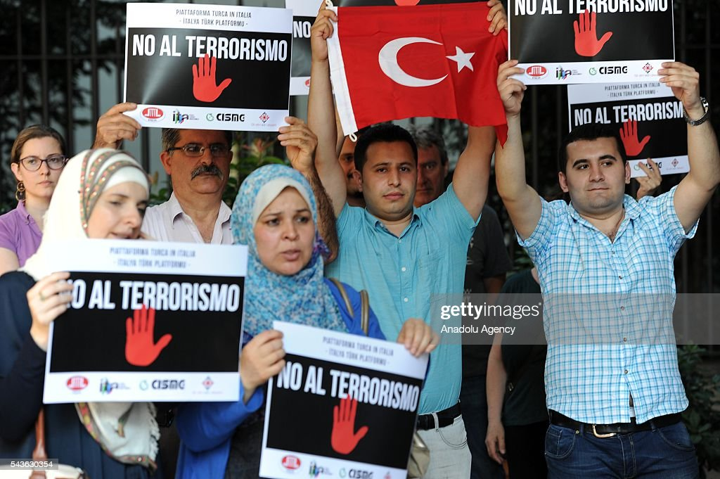 People attend a demonstration for the victims of the terrorist attack at Ataturk International Airport of Istanbul, outside the Turkish consulate in Milan, Italy on June 29, 2016. At least 41 victims and three suicide bombers were killed while scores of others were injured in a terror attack on Istanbul.