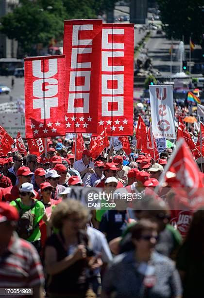 People attend a demonstration organized by CCOO and UGT Union workers in Madrid on June 16 2013 against austerity policies and record high...