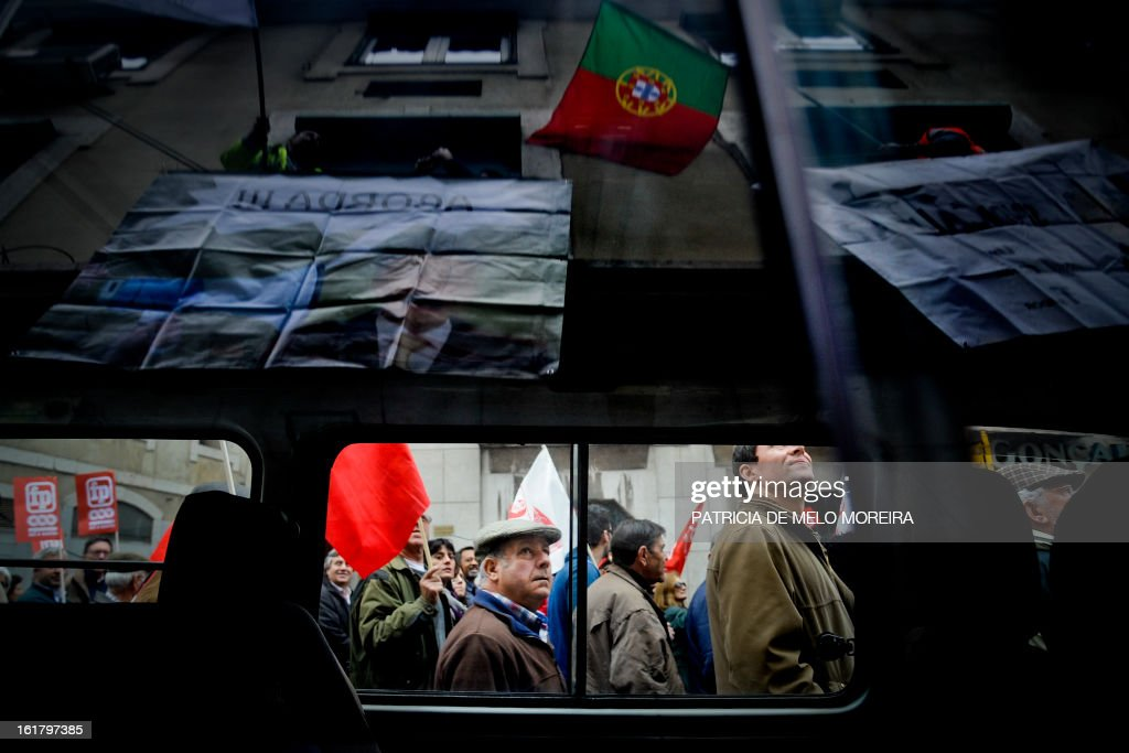 People attend a demonstration organized by Portugal's biggest trade union CGTP (Portuguese General Workers Confederation) against government austerity measures in Lisbon, on February 16, 2013.