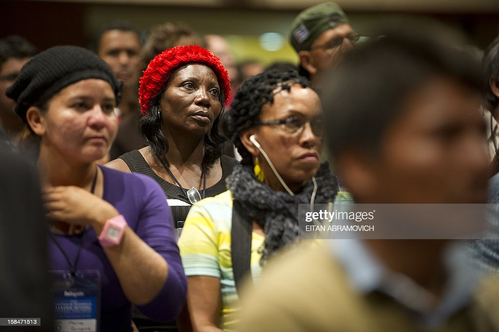 People attend a forum on agricultural policy in Bogota, Colombia, on December 17, 2012, in the sidelines of the peace talks that Colombia's government and the FARC rebel group are holding in Cuba. AFP PHOTO/Eitan Abramovich