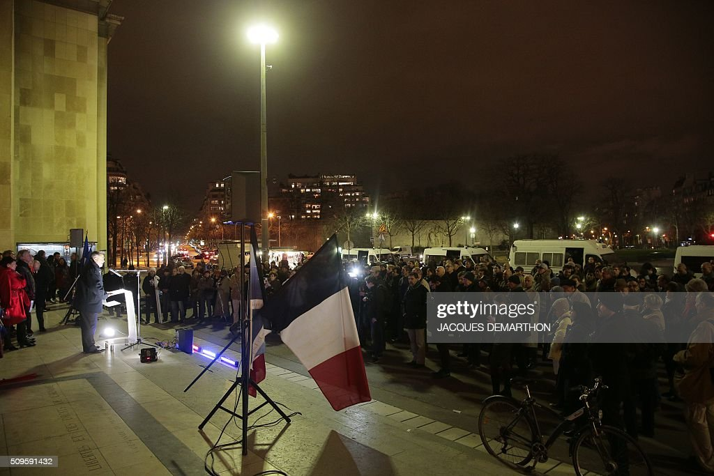 People attend a gathering initiated by French far-right political group SIEL in support of former general Christian Piquemal, on February 11, 2016 on the Human Rights square in Paris. Piquemal, a former general with the prestigious French foreign legion from 1994 to 1999, was arrested in the French port of Calais on February 6 after scuffles with police at a banned rally in support of a Europe-wide initiative by the Islamophobic Pegida movement. / AFP / JACQUES DEMARTHON