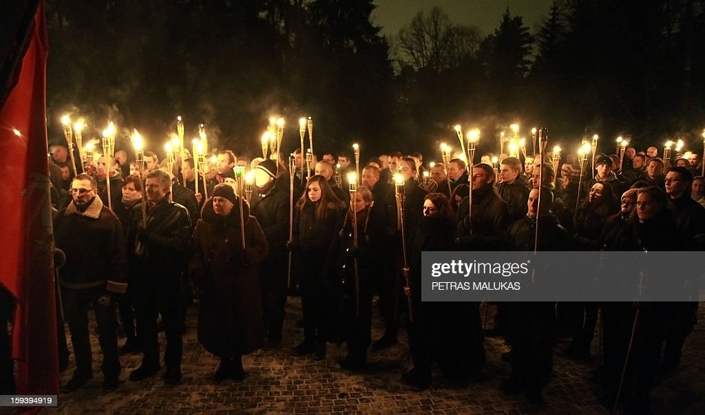 People attend a 'January Event' commemoration ceremony at the Antakalnis cemetery in Vilnius on January 12, 2013. Victims of the so called 'January Events' of 1991 are buried at the cemetary. On January 13, 1991 Soviet troops tried to crush the new Lithuanian state.