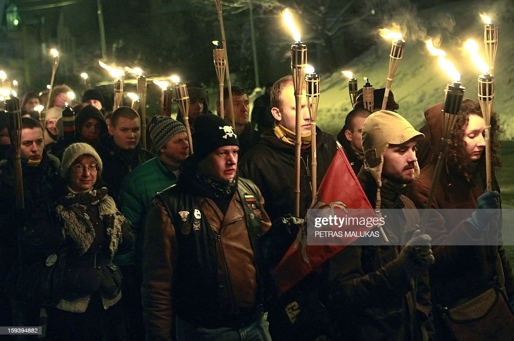 People attend a 'January Event' commemoration march to the Antakalnis cemetery in Vilnius on January 12, 2013. Victims of the so called 'January Events' of 1991 are buried at the cemetary. On January 13, 1991 Soviet troops tried to crush the new Lithuanian state.