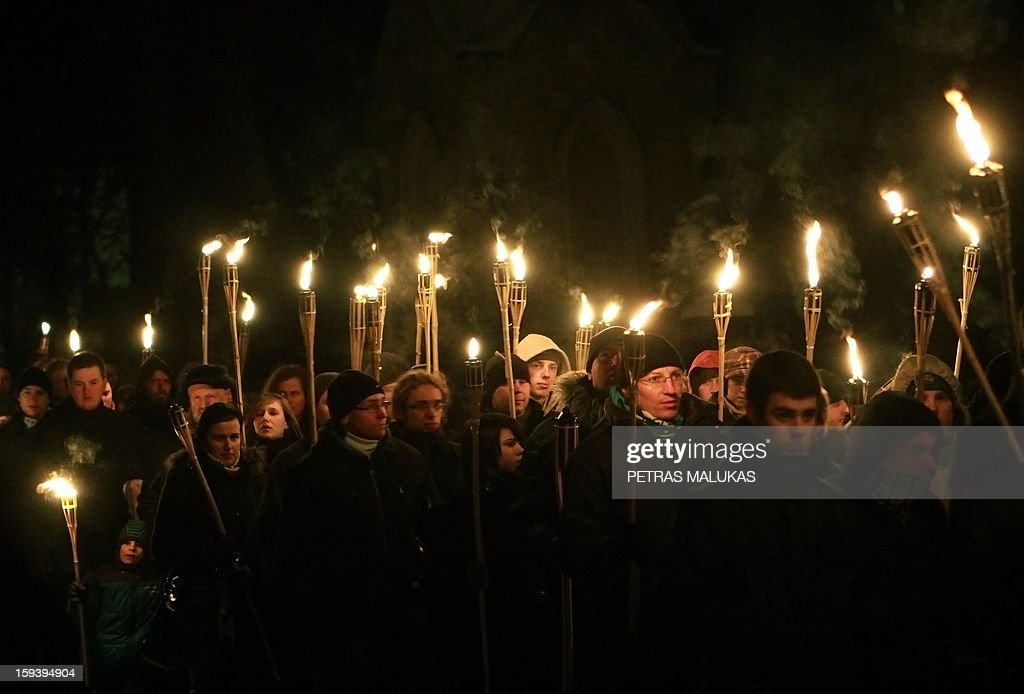 People attend a 'January Event' commemoration march to the Antakalnis cemetery in Vilnius on January 12, 2013. Victims of the so called 'January Events' of 1991 are buried at the cemetary. On January 13, 1991 Soviet troops tried to crush the new Lithuanian state. AFP PHOTO / PETRAS MALUKAS