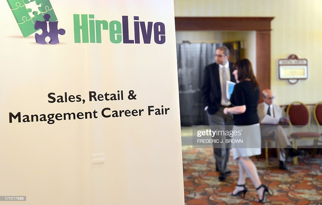 People attend a job fair hosted by HireLive for sales, retail and management professionals in Arcadia, California on August 22, 2013. Filing new claims for unemployment benefits by Americans increased last week but stayed close to a six-year low. AFP PHOTO/Frederic J. BROWN