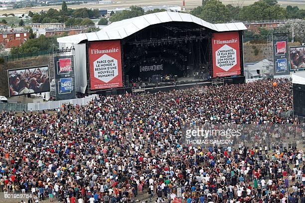 People attend a live show during the Fete de l'Humanite in La Courneuve near Paris on September 10 2016 / AFP / Thomas SAMSON