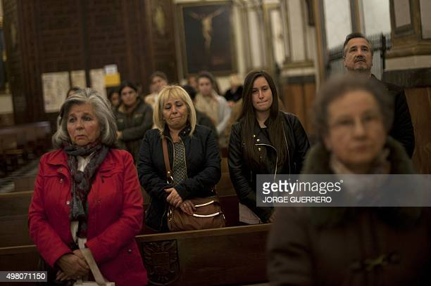 People attend a mass funeral held in Santos Justo y Pastor Church in Granada in memory of Juan Alberto Gonzalez Garrido one of the victims of the...