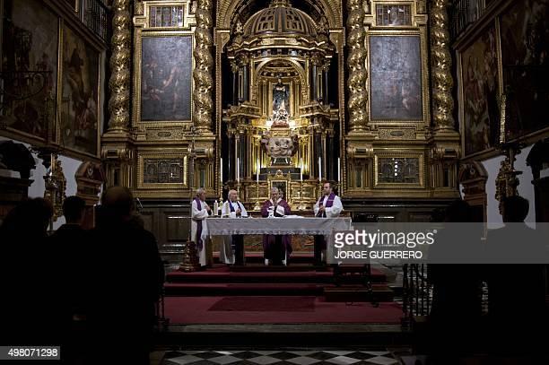 People attend a mass funeral held in Santos Justo y Pastor Church in Granada by Granada Archbishop Francisco Javier Martinez Fernandez in memory of...