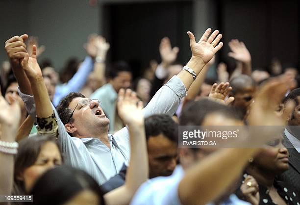 People attend a mass of the Assembly of God church in Goiania Goias State Brazil on May 19 2013 The election of evangelical minister Marco Feliciano...