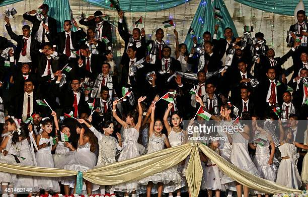 People attend a mass wedding ceremony in Beit Lahia city of Gaza on July 20 2015 300 couples got married in the ceremony organized by a charity in...