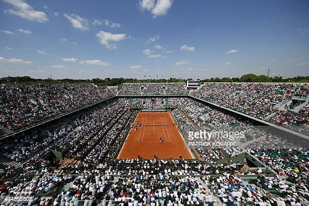 People attend a match at the Philippe Chartier court during the men's second round of the Roland Garros 2015 French Tennis Open in Paris on May 27...