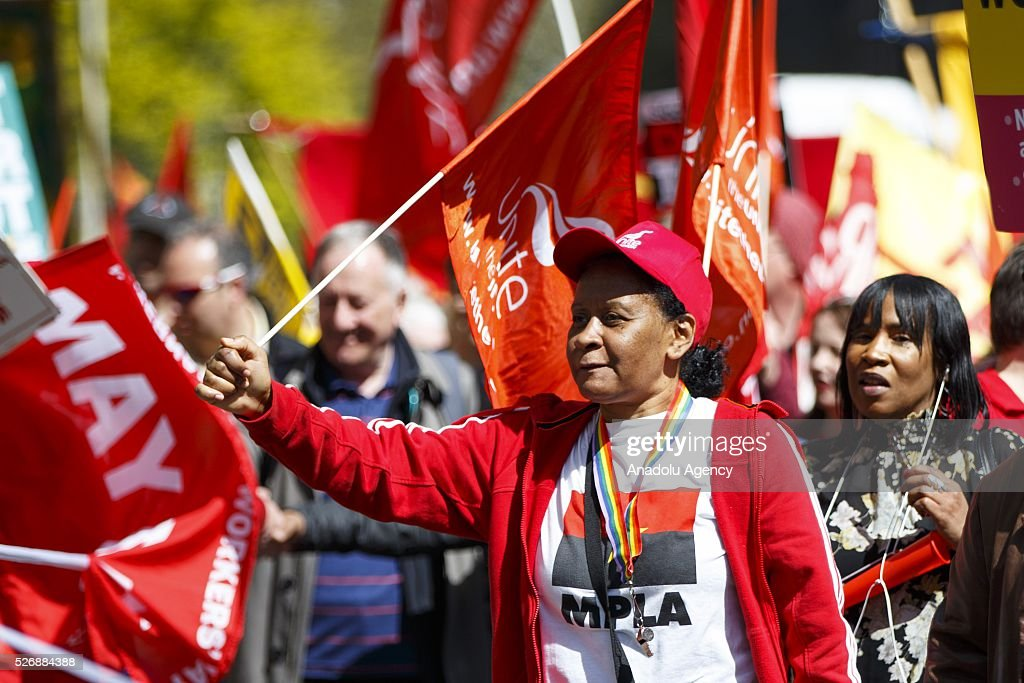 People attend a May Day march in London, England to celebrate International Workers' Day on May 1, 2016.