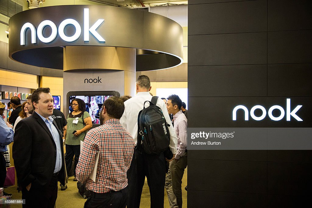 People attend a media event introducing the new Samsung Galaxy Tab 4 Nook on August 20 2014 in New York City The new tablet has a 7inch screen and...