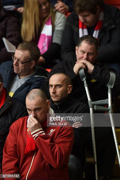 People attend a memorial service at Anfield in Liverpool north west England on April 15 on the 27th anniversary of the Hillsborough Disaster 96...