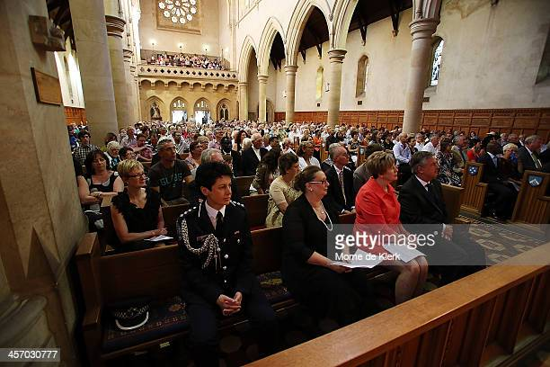 People attend a memorial service for former South African President Nelson Mandela at St Peter's Cathedral on December 16 2013 in Adelaide Australia...