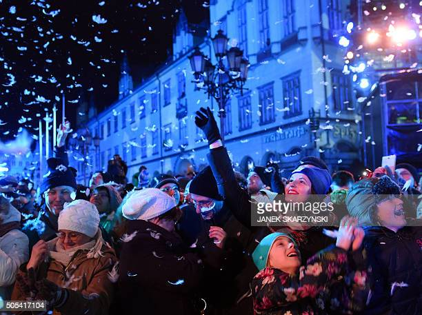 People attend a performance at the market square in Wroclaw on January 172016 to officially mark the inauguration of the city as the 2016 European...