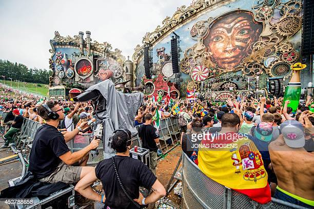 People attend a performance on the mainstage on the third day of the second weekend of the 10th edition of the Tomorrowland electronic music festival...