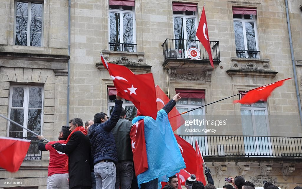 People attend a protest in reaction to display of terrorist organization PKK's flag at Turkish consulate's balcony, in front of Consulate General of Turkey in Bordeaux, France on February 14, 2016.