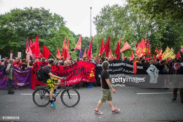 People attend a protest march against the G20 Summit with the topic 'Solidarity without borders instead of G20' in Hamburg Germany on July 8 2017...