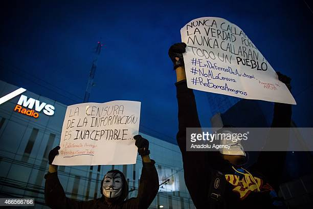 People attend a protest to support Carmen Aristegui outside the media chain MVS where she worked in Mexico City Mexico on March 16 2015 Carmen...