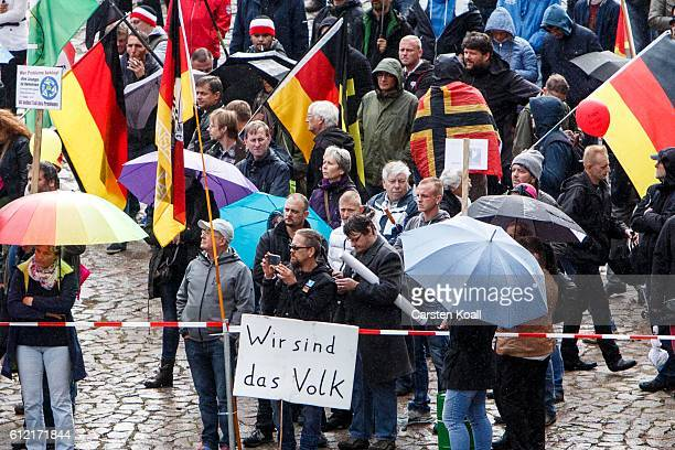 People attend a ralley of right wing citizens movement 'Festung Europa' on German Unity Day on October 3 2016 in Dresden Germany Unity Day called Tag...