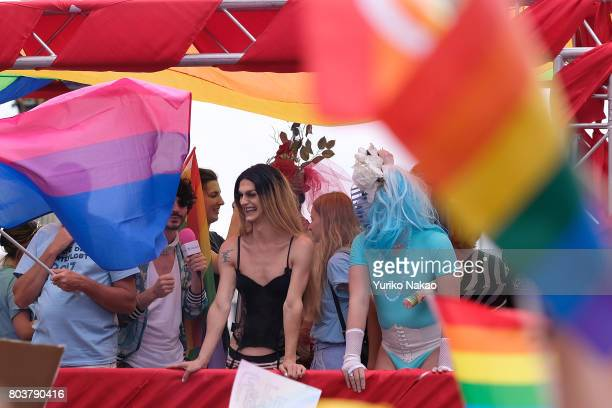 People attend a rally ahead of the Paris Gay Pride Parade or known as Marche des Fiertés LGBT in France at the Place de la Concorde on June 24 2017...