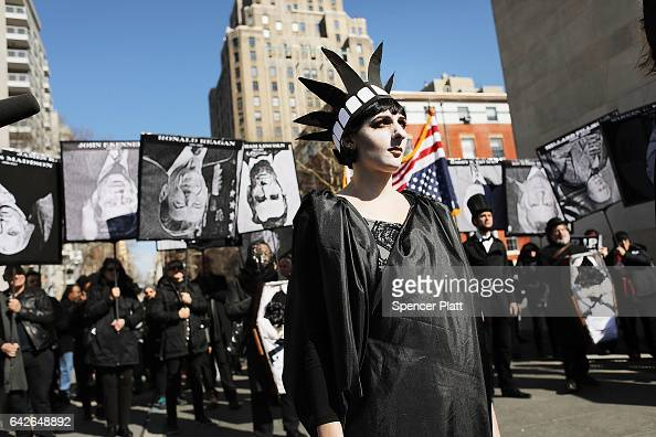 People attend a rally and a mock funeral for the United States Presidency in Washington Square Park on February 18 2017 in New York City Dozens of...